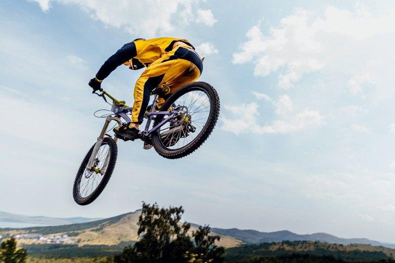 cyclist rider jump downhill mountain biking